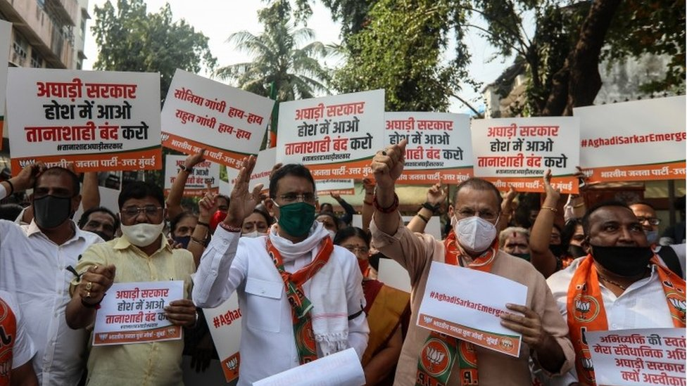 Activists of Bharatiya Janata Party (BJP) hold placards and shout slogans against the Maharashtra state government during a protest over the arrest of Arnab Goswami, news anchor of Indian television channel, in Mumbai, India, 04 November 2020.