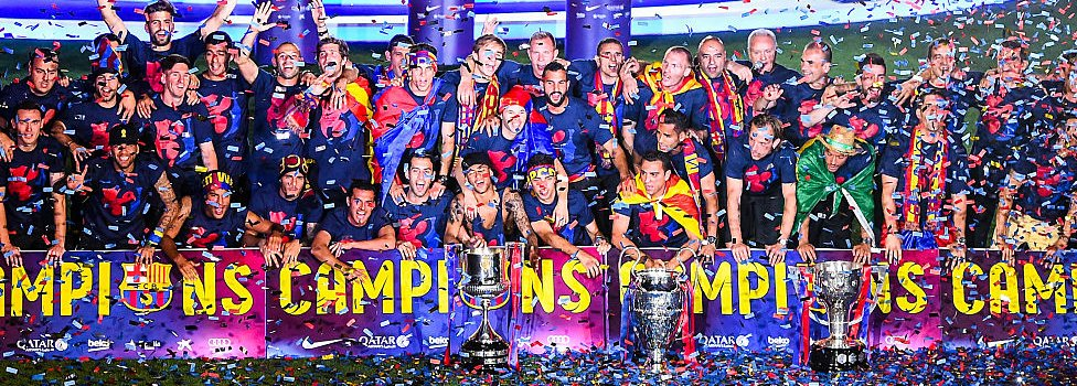 FC Barcelona players celebrate with La Liga, Copa del Rey and Champions League trophies during their victory parade after winning the UEFA Champions League Final at the Camp Nou Stadium on 7 June 2015 in Barcelona, Spain