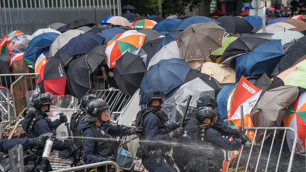A group of riot police try to attack the protester's front line in Hong Kong.