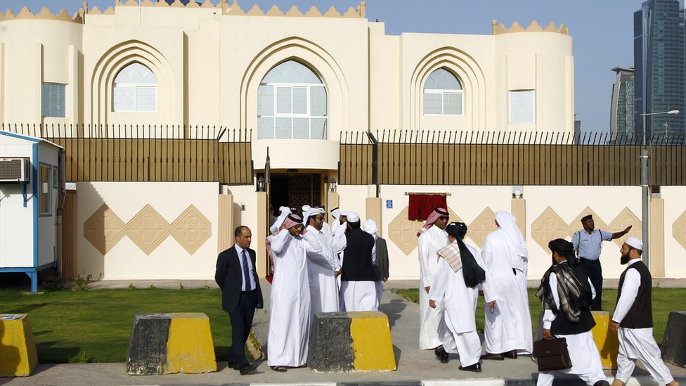 Guests arrive for the opening ceremony of the new Taliban political office in Doha on June 18, 2013
