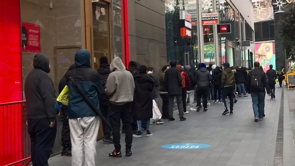 Customers queue for click and collect at Westfield in Stratford, east London