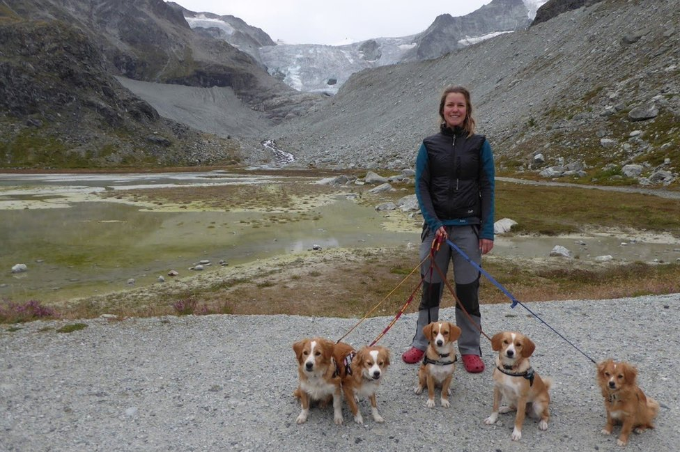 Esther and dogs next to lake
