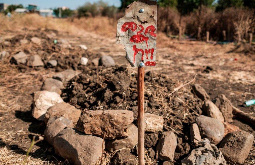 Freshly dug grave