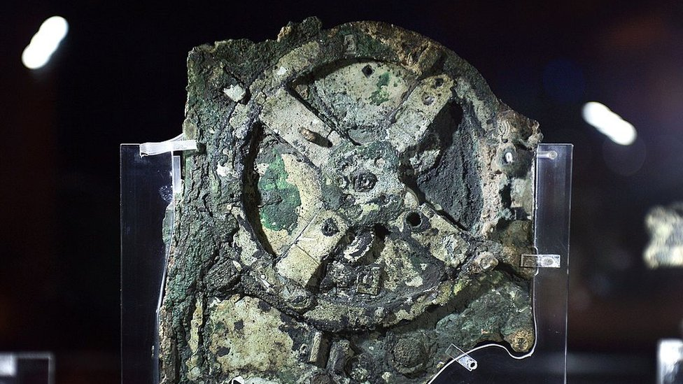 Image shows a piece of the Antikythera Mechanism at museum in Greece