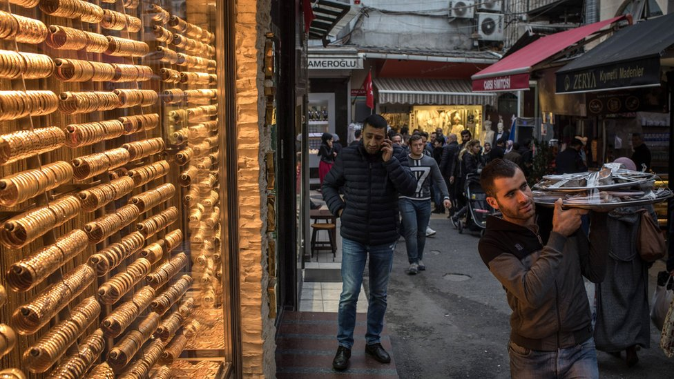 People walk past a gold store in Istanbul