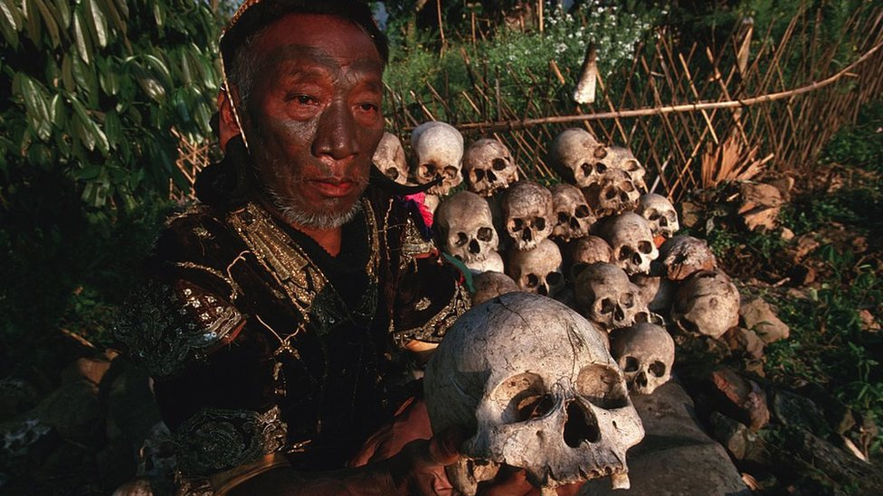 A Naga chief shows a collection of skulls secretly hidden under stones in 1998, despite an order from the Indian government to destroy them