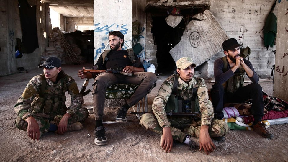 Rebel fighters from the Nur al-Din al-Zinki faction rest in rebel-held Aleppo province (23 September 2018)