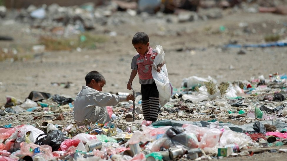 Yemeni children stand amid rubbish at a slum in the capital Sana'a on 12 March 2016