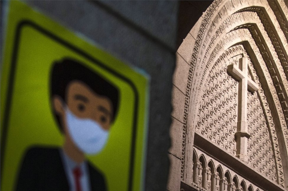 A cartoon image of a man wearing a mask appears next to an ornate church door.