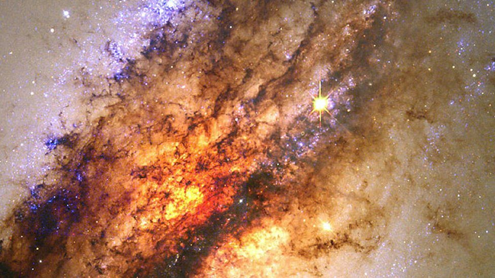 A galaxy disappearing into a black hole, c 2000.