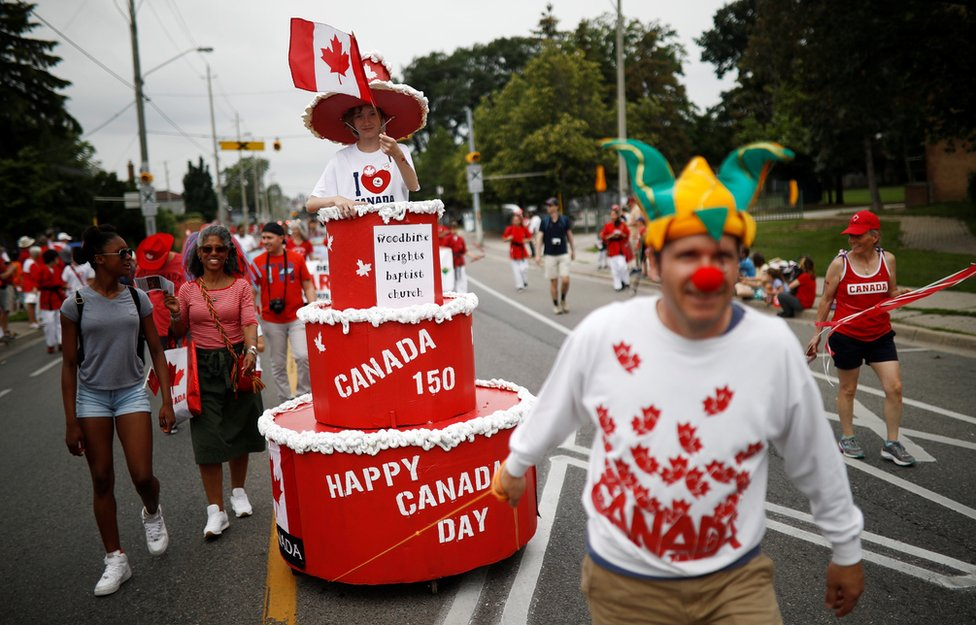 """People participate in the East York Toronto Canada Day parade, as the country marks its 150th anniversary with """"Canada 150"""" celebrations, in Toronto, Ontario, Canada"""
