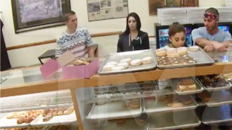 Ariana Grande licks a doughnut