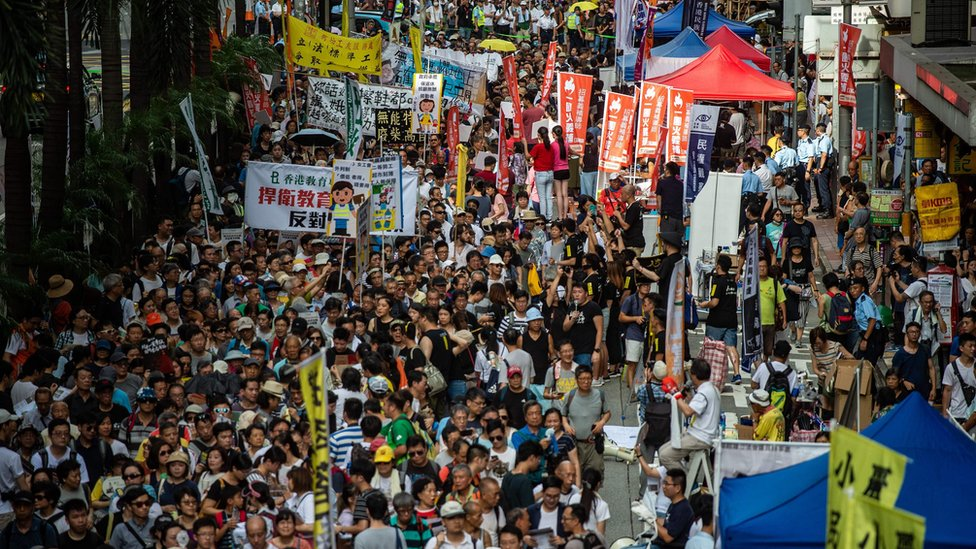 People attend a protest march in Hong Kong on July 1, 2018, to coincide with the 21st anniversary of the city's handover from British to Chinese rule.