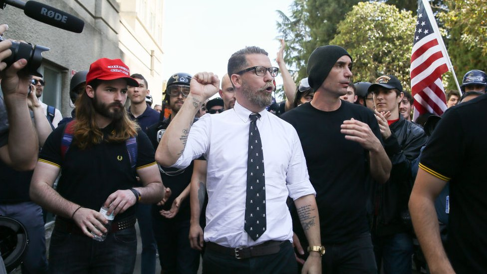 Vice co-founder Gavin McInnes (centre) pumps his fist during a rally in Berkeley, California.