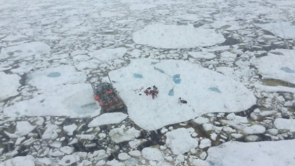 Cormorant helicopter from rescues 5 crew members from fishing vessel trapped in ice and taking on water