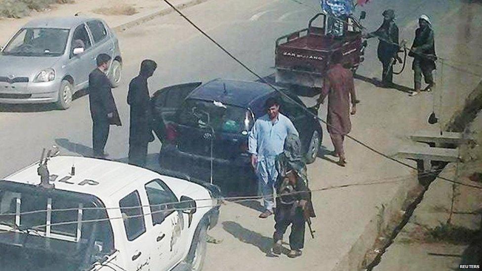 Taliban fighters patrol the streets of Kunduz