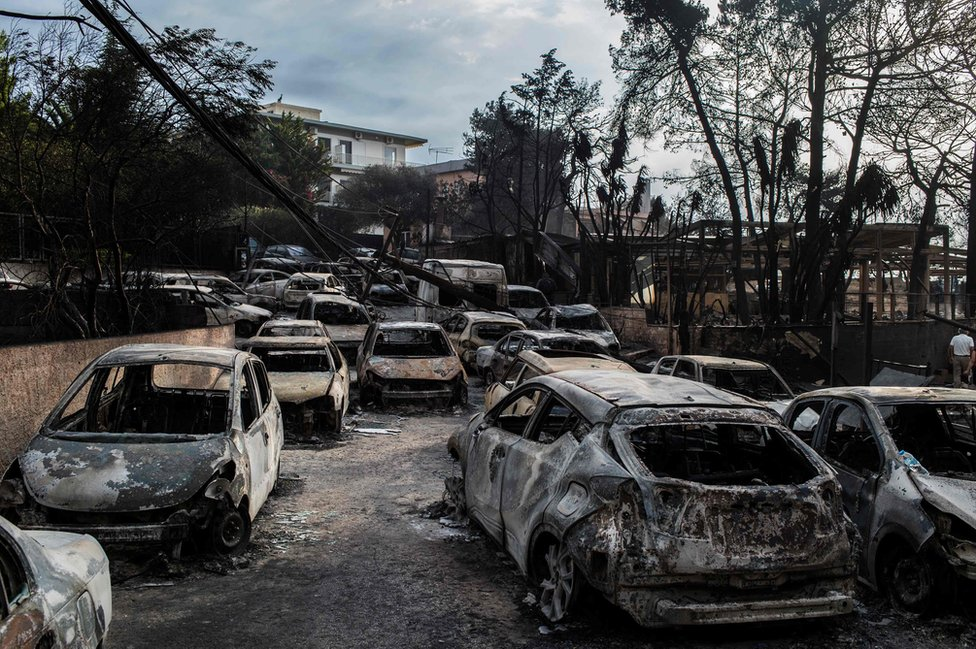 This photo show cars burnt following a wildfire at the village of Mati.