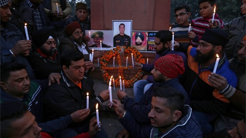 Indian people and members of National Human Rights and Crime Control Organization light candles in front of portraits of Indian security personnel who lost their lives in the Pathankot militant attack at Air Force base, during a tribute paying ceremony in Amritsar, India, 03 January 2016