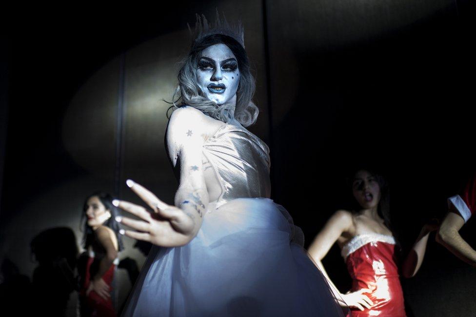 Elias performs onstage as Melanie Coxxx