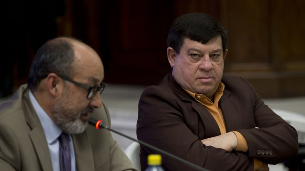 Former army officer Esteelmer Francisco Reyes Giron, right, listens to his lawyer Moises Galindo, Guatemala City, 25 Feb 2016