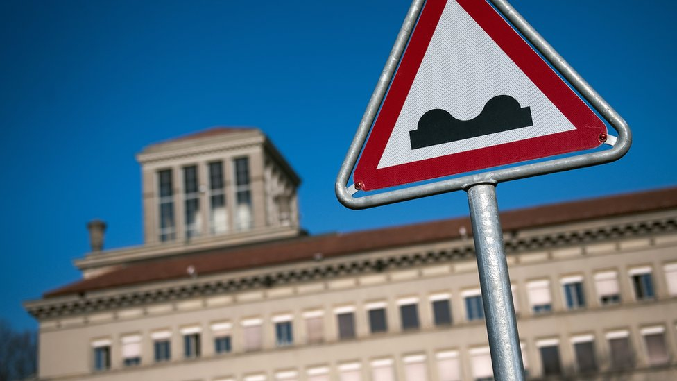 A road sign in front of the World Trade Organization (WTO) headquarters in Geneva