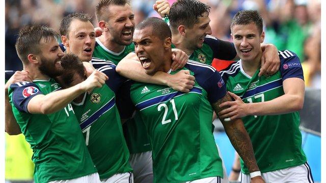 Northern Ireland players celebrate victory over Ukraine
