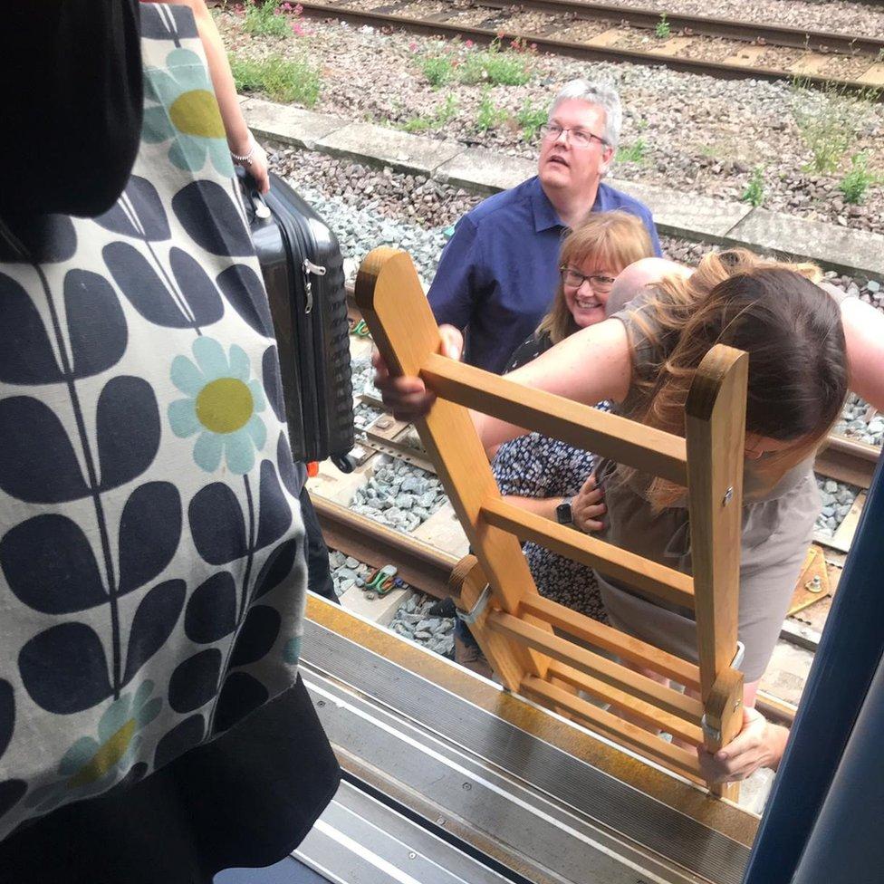 Passengers disembarked a train near Kentish Town station and began walking along the tracks