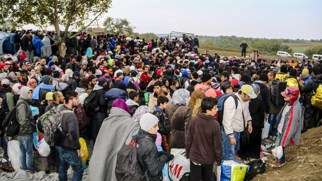 Crowd of people at border