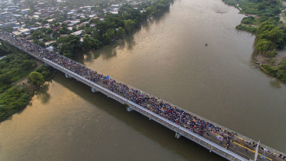 The migrant caravan crosses from Guatemala into Mexico, in October 2018
