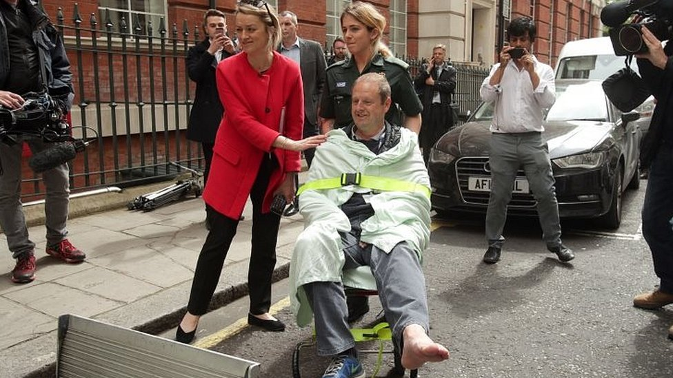 """BBC""""s Laura Kuenssberg comforts her her colleague, BBC cameraman Giles Wooltorton, after the car carrying Jeremy Corbyn ran over his foot as it arrived at the Institute of Engineering in London"""