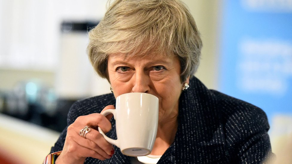 Theresa May drinking