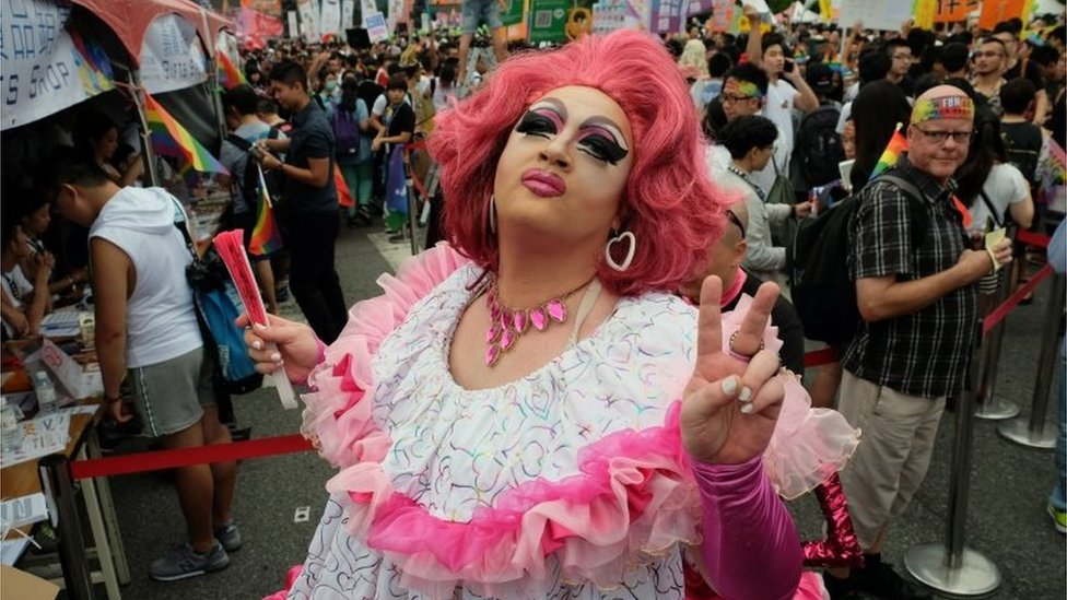 A participant poses during the annual Taiwan lesbian, gay, bisexual and transgender pride parade in Taipei on 29 October 2016.