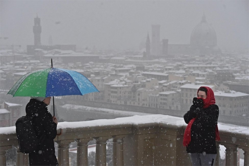 A view of snow falling over Florence, Italy, 1 March 2018