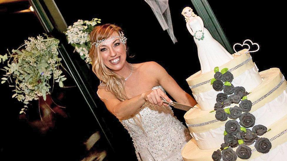 Laura Mesi, who married herself, cuts her wedding cake