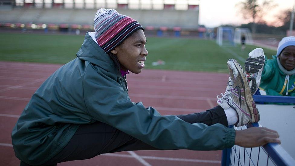 Caster Semenya stretches before training