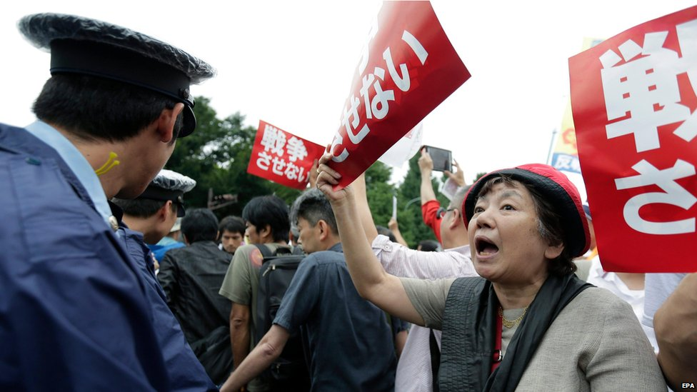 Demonstrator shouts slogans outside Japanese parliament, Tokyo (30 August)