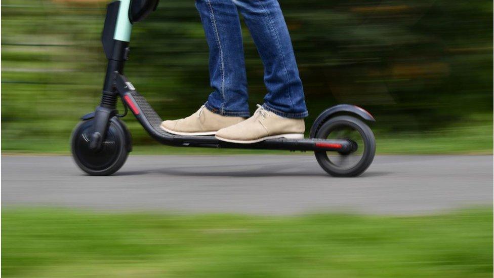 Man rides e-scooter
