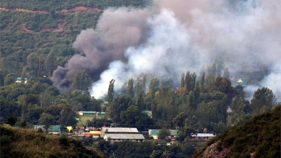 Smoke billows out from inside an Indian Army base which was attacked by suspected militants in Uri, some 115 west of Srinagar, the summer capital of Indian Kashmir, 18 September 2016.