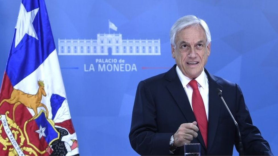 Handout picture released by the Chilean Presidency showing Chilean President Sebastian Pinera speaking to the nation in Santiago, on October 22, 2019,