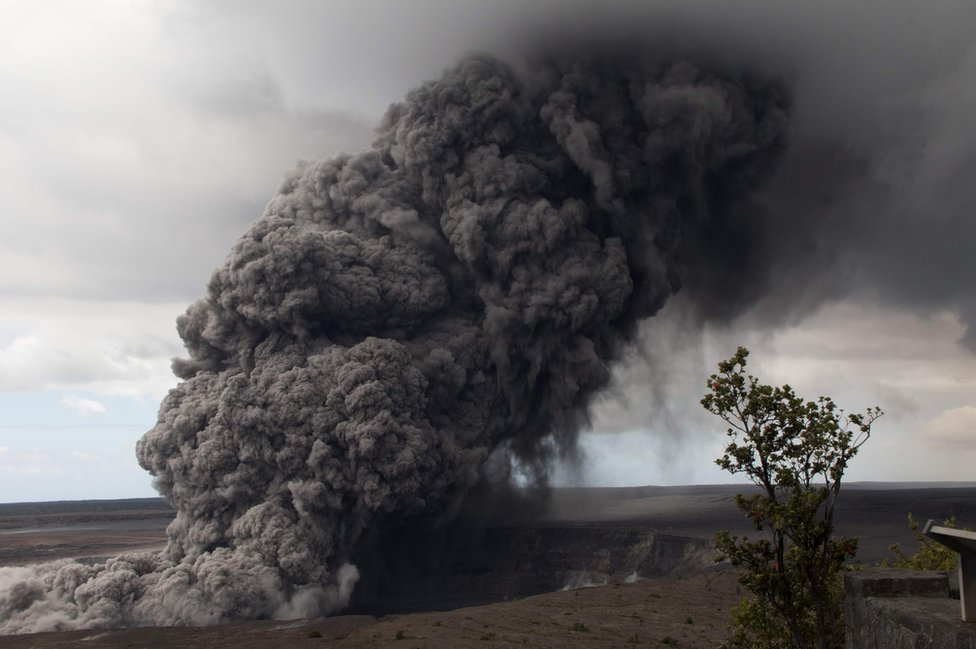 This US Geological Survey (USGS) image released on 15 May 2018 shows an ash plume rising following a massive volcano eruption on Kilauea volcano in Hawaii