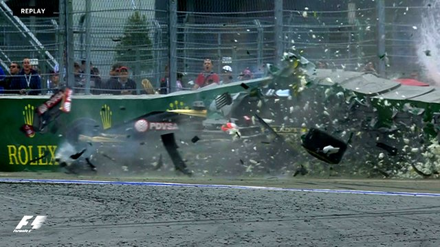 Romain Grosjean crashes his Lotus during the Russian Grand Prix