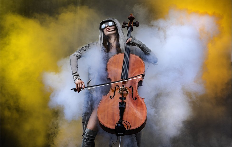 Cellist surrounded by smoke