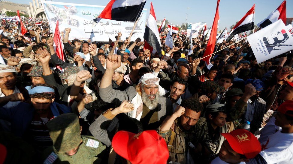 Houthi supporters attend a rally to mark the third anniversary of the Saudi-led coalition intervention in Yemen's war (26 March 2018)