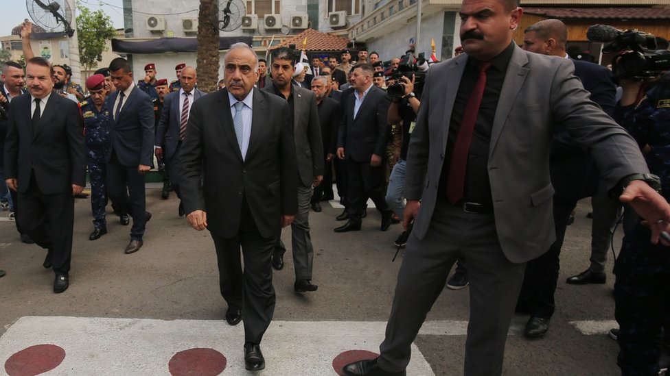 Iraqi Prime Minister Adel Abdul Mahdi arrives at a funeral ceremony in Baghdad (23 October 2019)