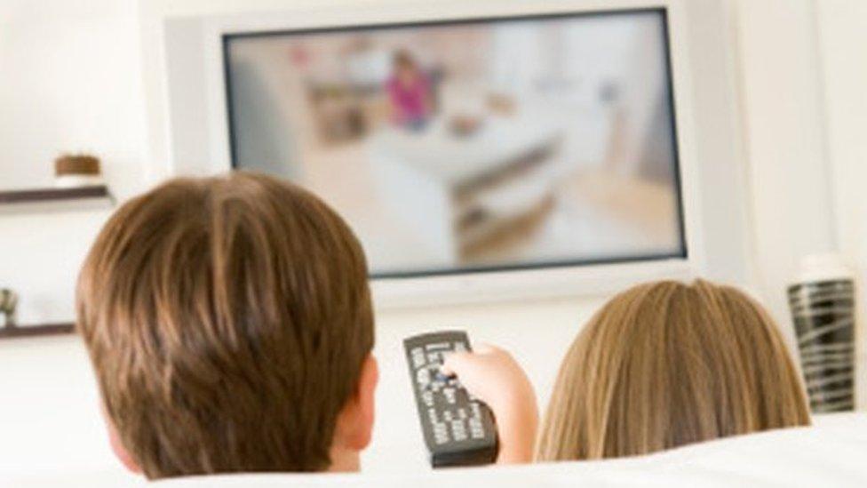 Rear shot children watch tv