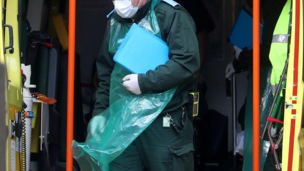 Paramedic wearing protective apron