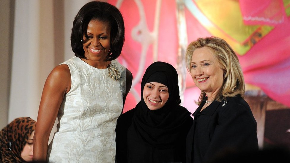 US First Lady Michelle Obama (L) and Secretary of State Hillary Clinton pose with Samar Badawi of Saudi Arabia as she receives the 2012 International Women of Courage Award during a ceremony at the US State Department in Washington, DC, on March 8, 2012