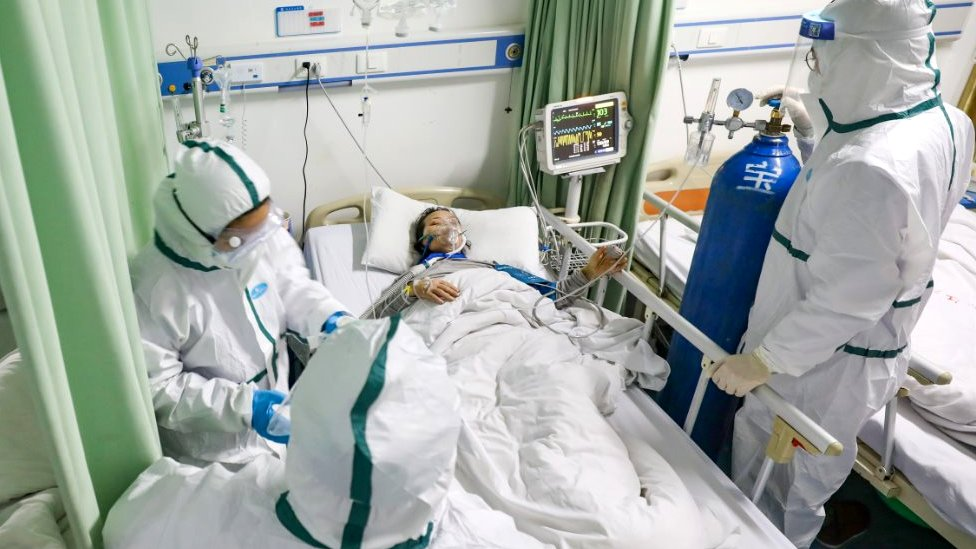 Patient in hospital bed in Wuhan