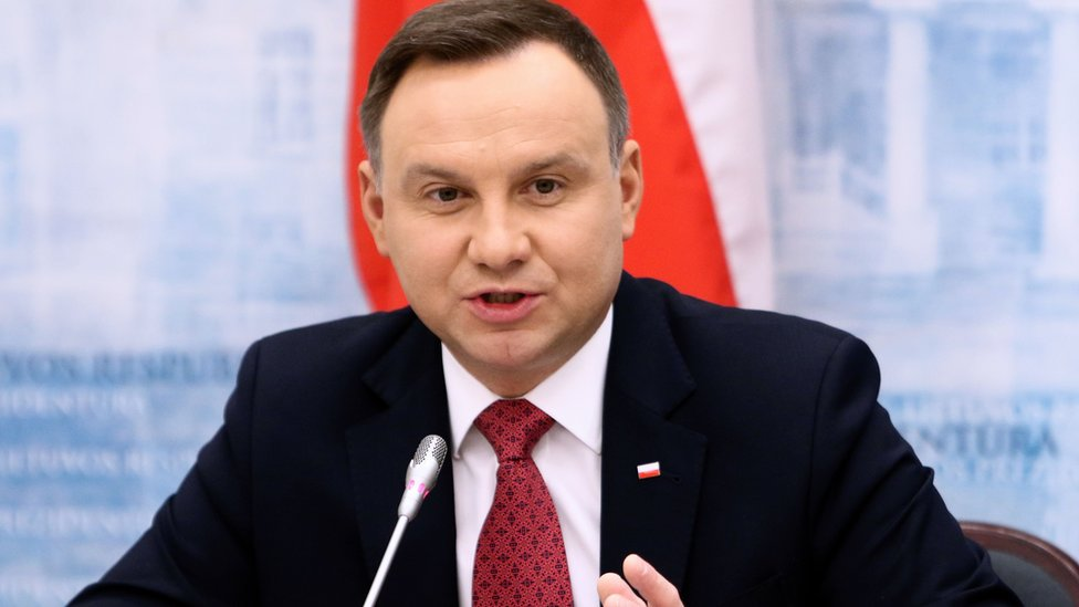 Poland's President Andrzej Duda gestures as he gives a press conference on 17 February