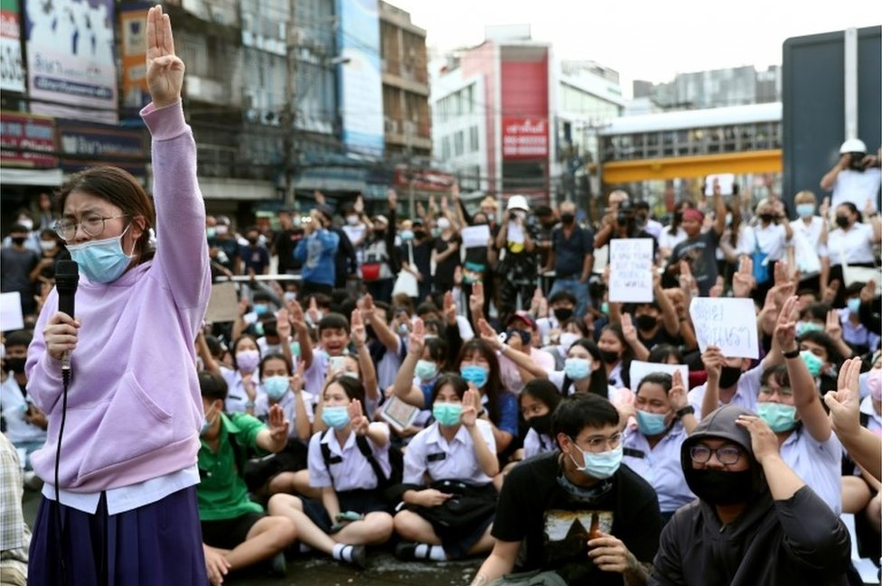 Pro-democracy protesters show the three-finger salute during an anti-government protest, in Bangkok, Thailand October 19, 2020.
